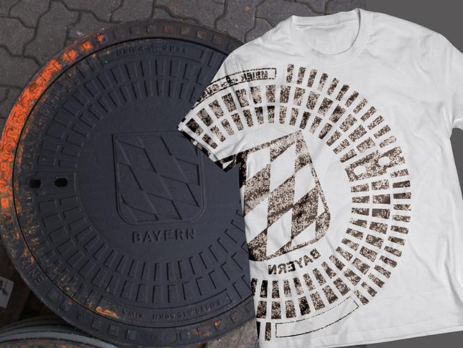 Merchandising für ein T-Shirt mit Gullideckel-Druck